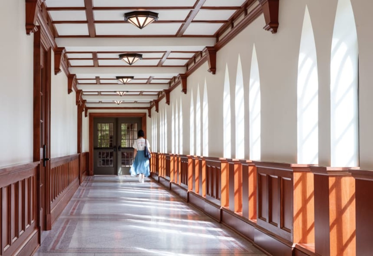 Arched windows allow a flood of sunlight into the halls. (Hall + Merrick Photographers)